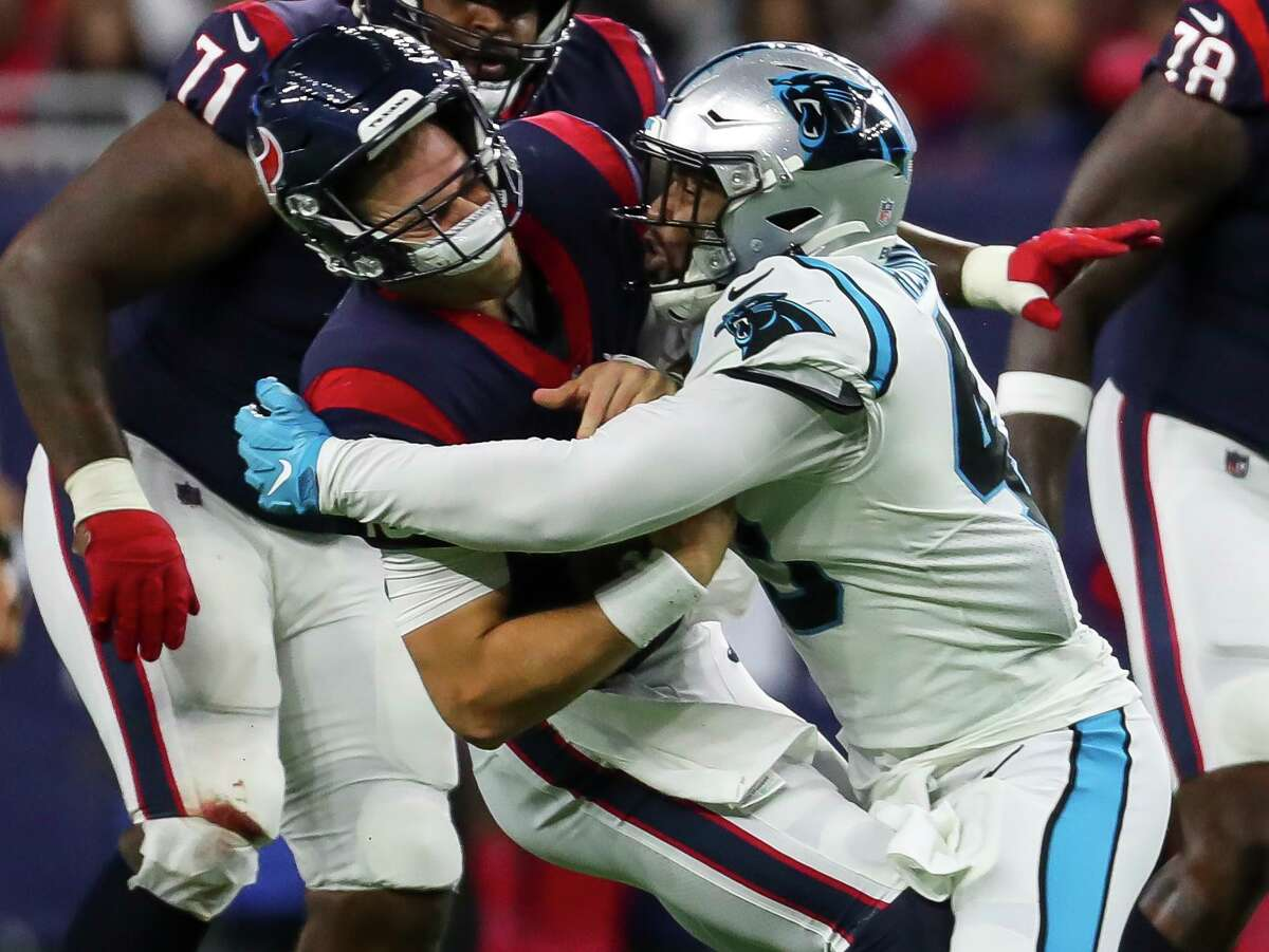 In his six quarters of action, Texans rookie quarterback Davis Mills has suffered five sacks, including this one by Panthers linebacker Haason Reddick.