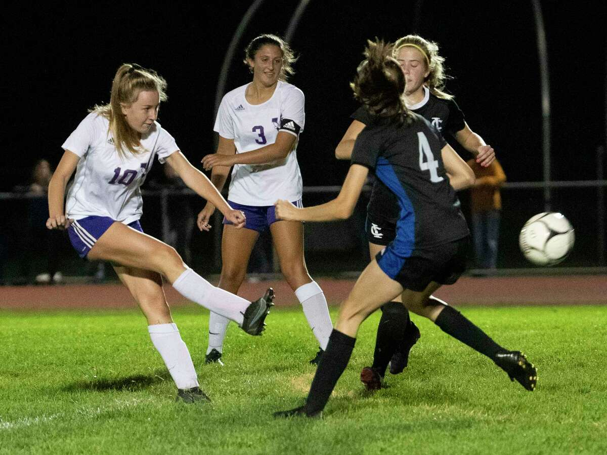 Voorheesville's Lily Farrell, left, scores during a soccer game against Ichabod Crane on Monday, Sept. 27, 2021 in Valatie, N.Y.