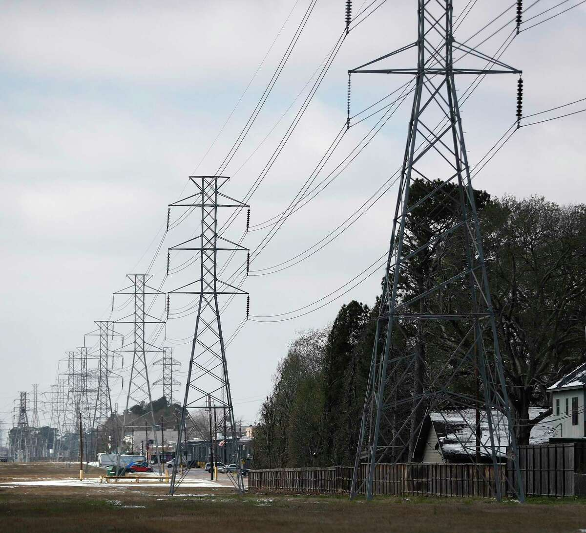 Power lines cut through the Shepherd Forest subdivision, in Houston, Monday, February 15, 2021, after a winter storm with freezing rain and temperatures created a strain on the power grid, leaving 2.3 million Texas residents without power.