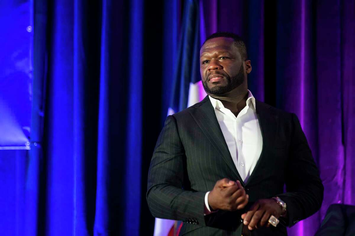 """Curtis """"50 Cent"""" Jackson listens during the induction ceremony for the G-Unity Business Lab, Monday, Sept. 27, 2021, at Wheatley High School in Houston. The initiative is a partnership between Curtis """"50 Cent"""" Jackson's G-Unity Foundation and Houston Independent School District. The business lab will offer MBA-style business classes for students interested in entrepreneurial endeavors."""