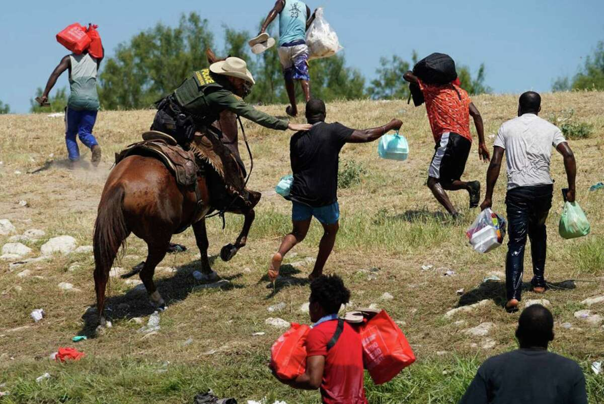 A United States Border Patrol agent on horseback tries to stop a Haitian migrant from entering an encampment on the banks of the Rio Grande near the Acuna Del Rio International Bridge in Del Rio, Texas on September 19, 2021. (Paul Ratje/AFP via Getty Images/TNS)