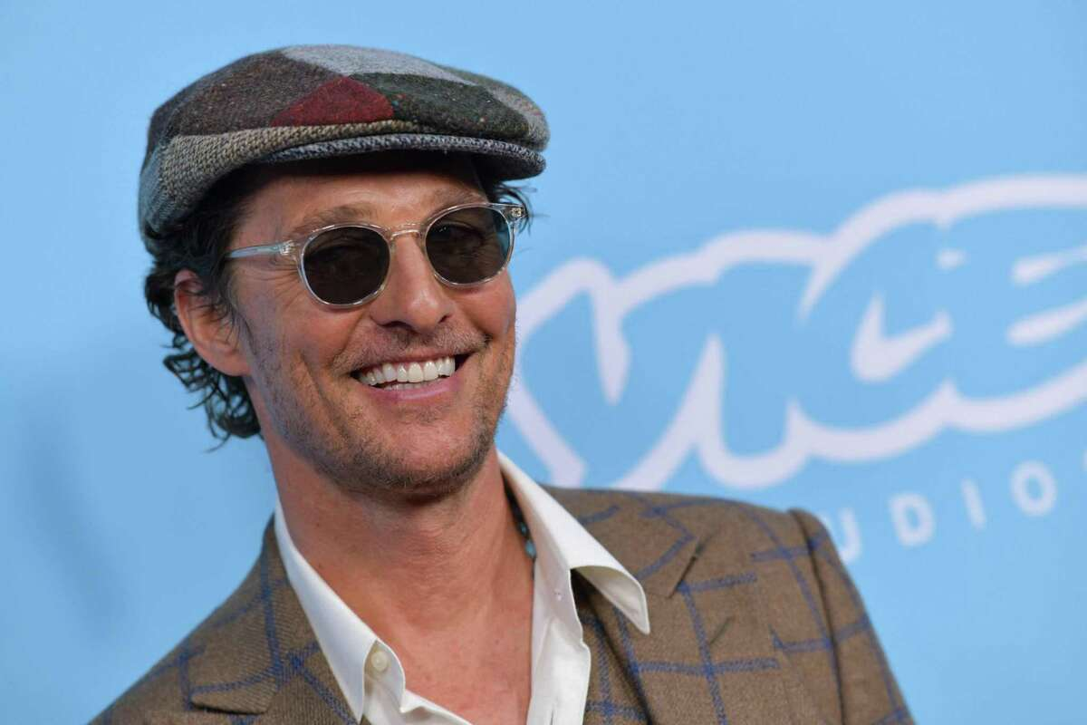 """(FILES) In this file photo taken on March 28, 2019, US actor Matthew McConaughey arrives for the Los Angeles premiere of """"The Beach Bum"""" at the Arclight Cinemas in Hollywood. - McConaughey is preparing for the first shots of what he says will be a """"100-year war"""" when Austin F.C. make their much-anticipated Major League Soccer bow this weekend, the actor said on April 13, 2021. The Hollywood star is a minority owner in the MLS expansion side and is determined to help the club successfully embed itself in his hometown as the franchise's """"minister of culture."""" (Photo by Chris Delmas / AFP) (Photo by CHRIS DELMAS/AFP via Getty Images)"""