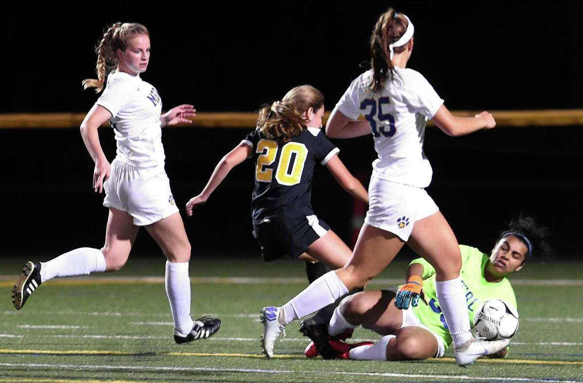 Mercy goalie Melina Ford blocks a shot in the second half against Daniel Hand in Madison on September 17, 2019.