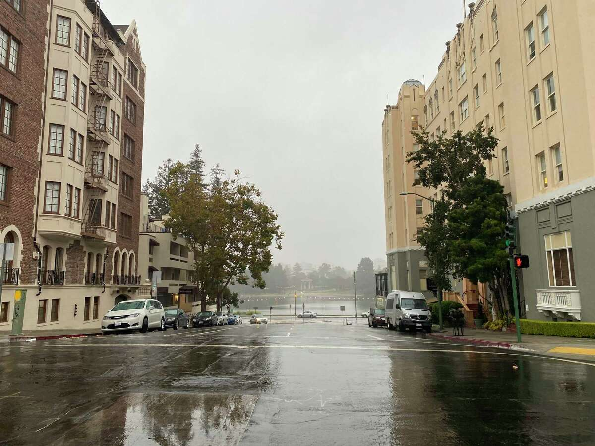 Rain falls in Oakland near Lake Merritt Monday afternoon. Meteorologists forecast drier conditions throughout the rest of the week.