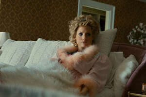 """Jessica Chastain is Tammy Faye Bakker in """"The Eyes of Tammy Faye,"""" an intimate look at the life of the televangelist and her husband, Jim, who rose from humble beginnings to create the world's largest religious broadcasting network."""