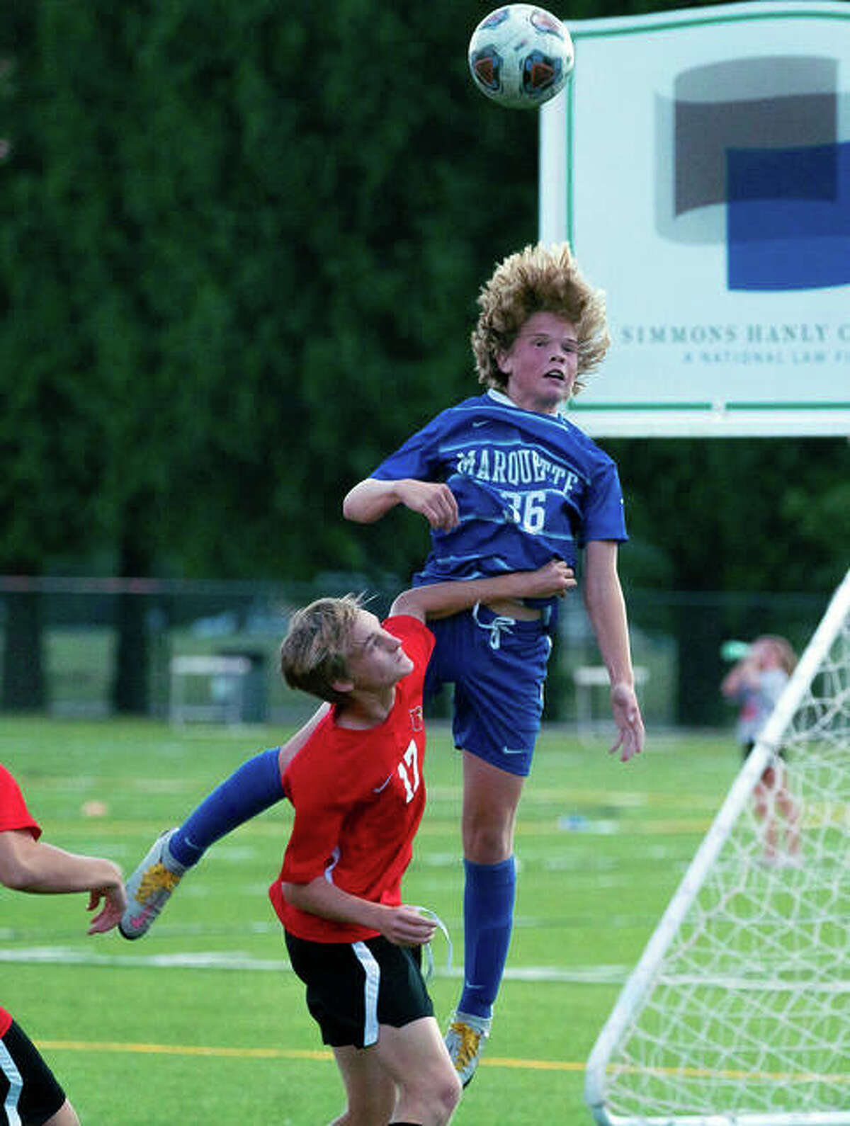 Marquette's Quinn Copeland goes high for a a header during Monday night's game at Gordon Moore Park.