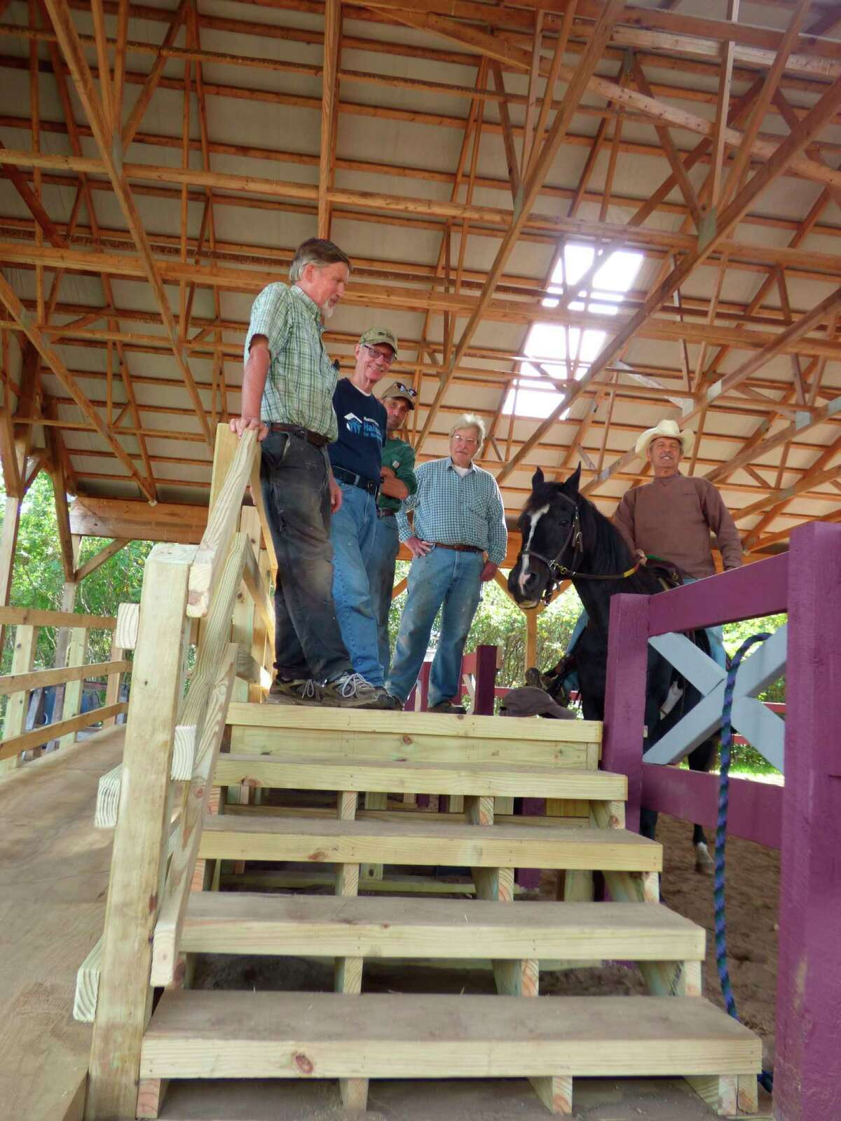 Habitat for Humanity volunteers replaced a platform at Northern Pathways Equine Center that will improve access to those with wheelchairs. (Scott Fraley/News Advocate)
