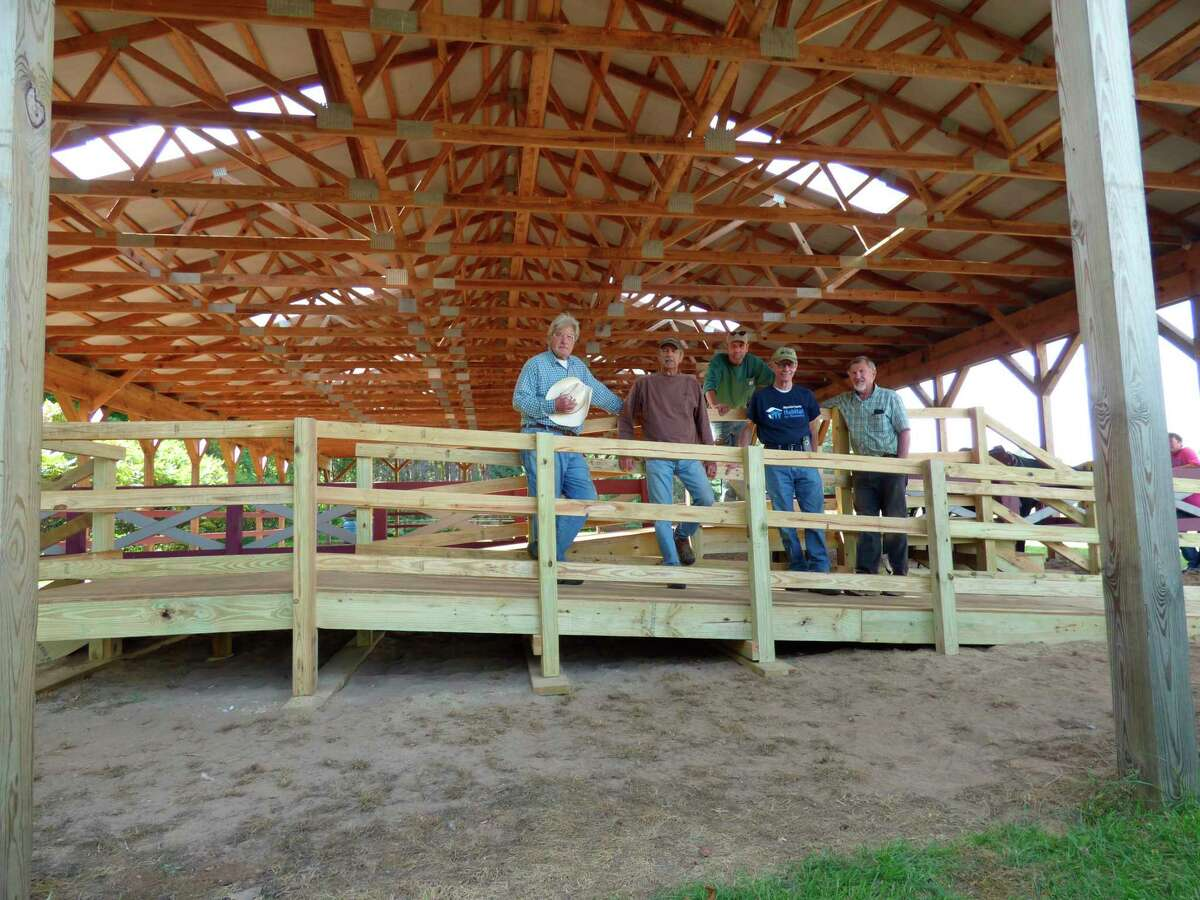 Habitat for Humanity volunteers finish a ramp at Northern Pathways Equine Center on Monday. (Scott Fraley/News Advocate)