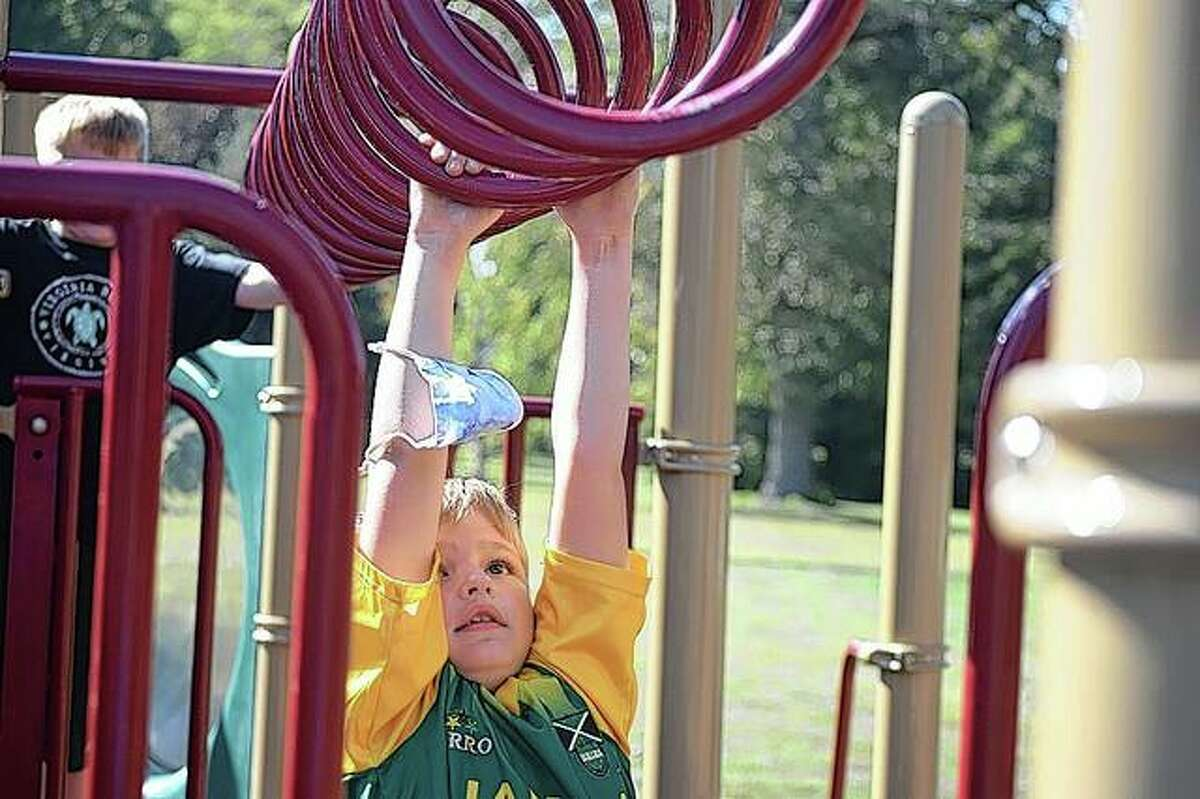 Jeffrey Wardell, 7, of Jacksonville plays Monday on the monkey bars in Community Park. Unseasonably warm temperatures Monday fell just shy of the record 92 degrees recorded in 2017. Temperatures are forecast to be above-average through at least Wednesday.