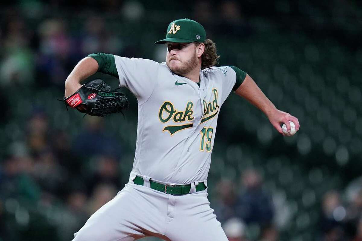 Oakland Athletics starting pitcher Cole Irvin throws against the Seattle Mariners in a baseball game Monday, Sept. 27, 2021, in Seattle. (AP Photo/Elaine Thompson)