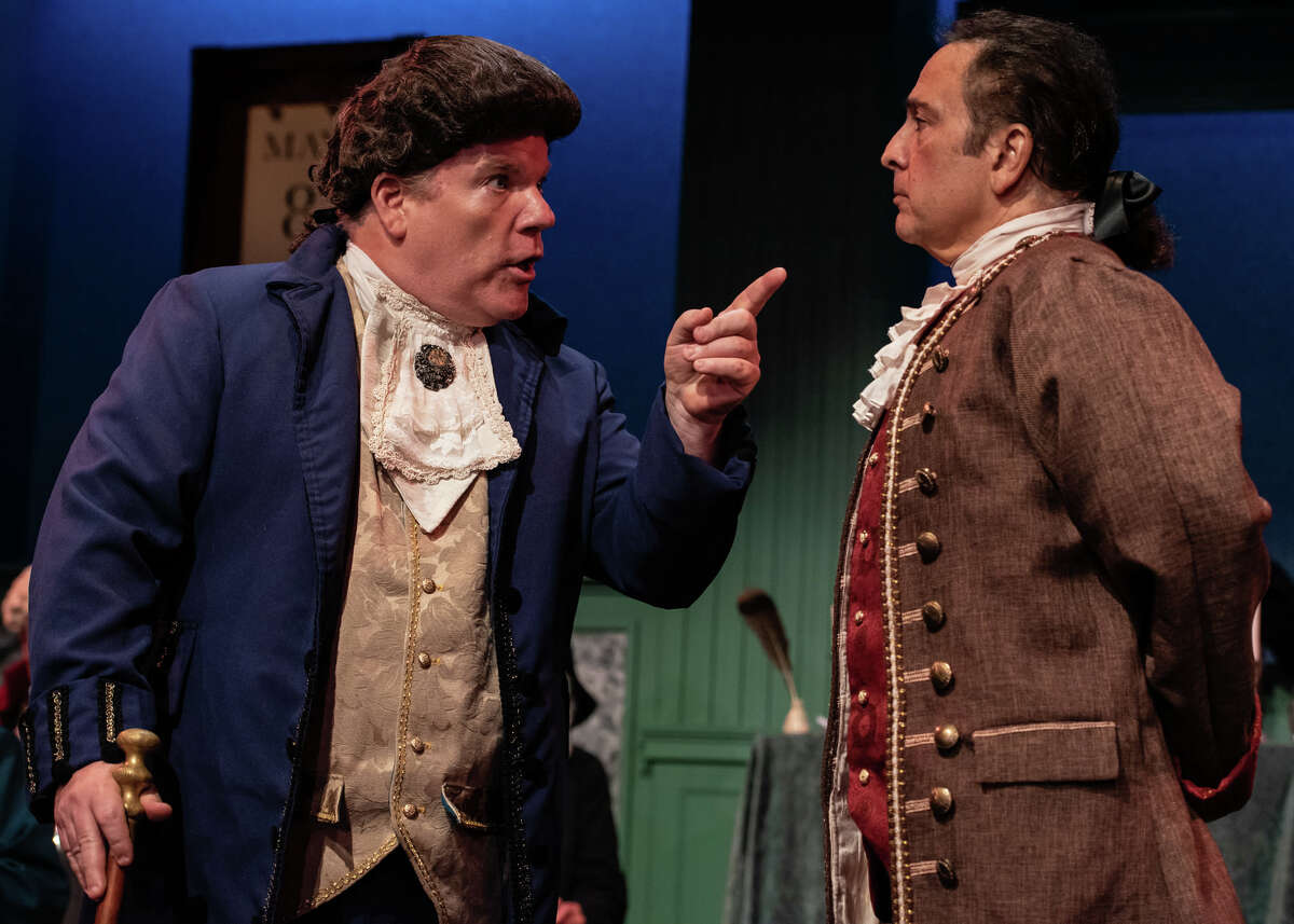 Fierce adversaries on the issue of American independence, John Dickinson and John Adams, seen here played by Bruce Crilly and Lou Ursone, respectively, face off in 1776 the musical playing in The Kweskin Theatre, Stamford thru Oct. 9.