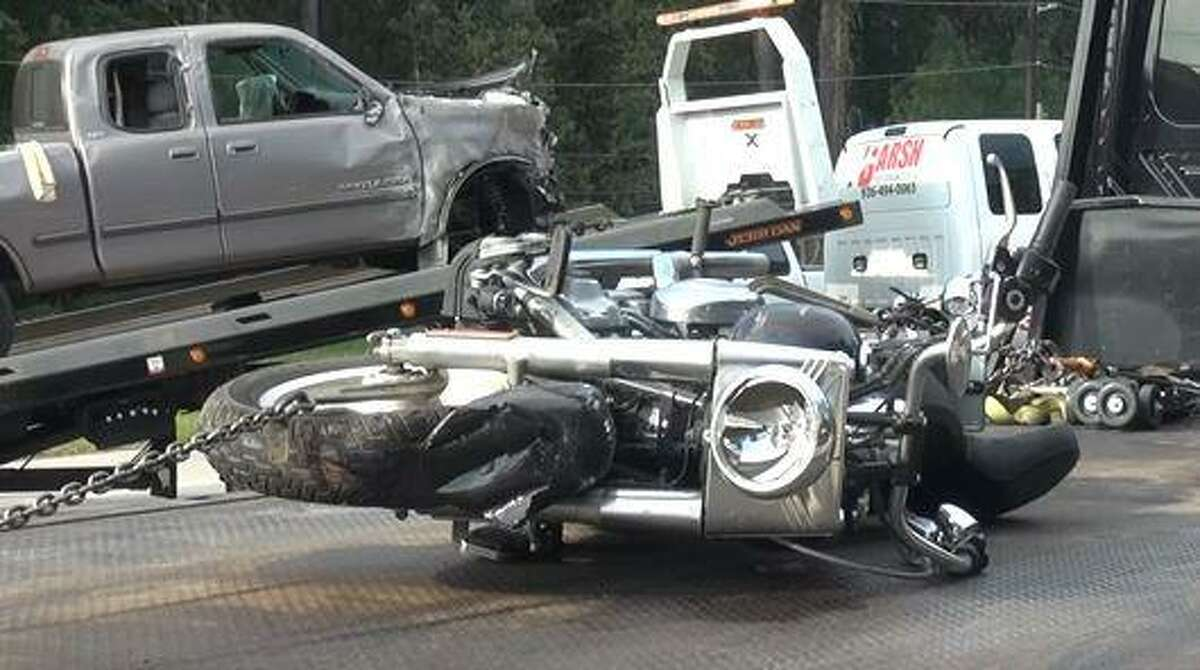 A motorcycle is seen after being removed off FM 1488 following a Monday morning crash where its driver died.