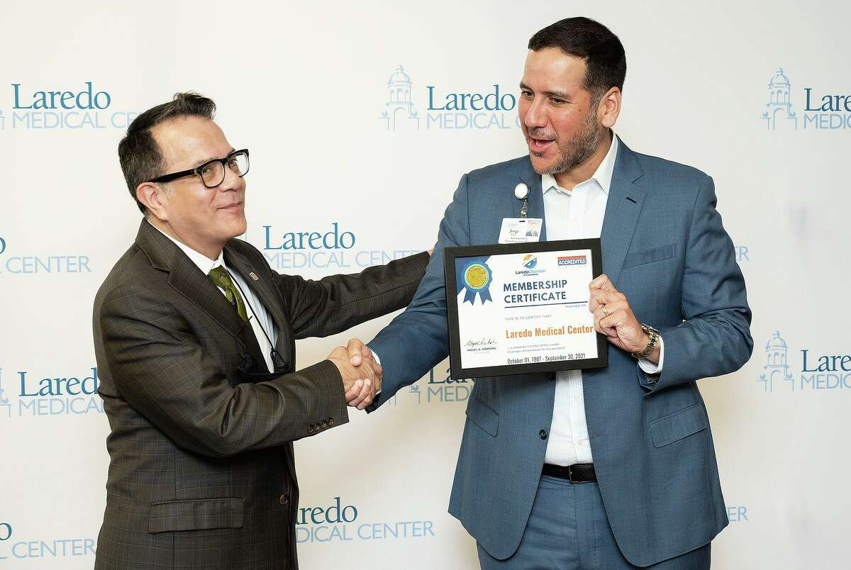 Laredo Chamber of Commerce Boardmember Gabriel Castillo presents a membership certificate to Laredo Medical Center CEO Jorge Leal for the new Infusion Center, Monday, Sept. 27, 2021, at LMC.