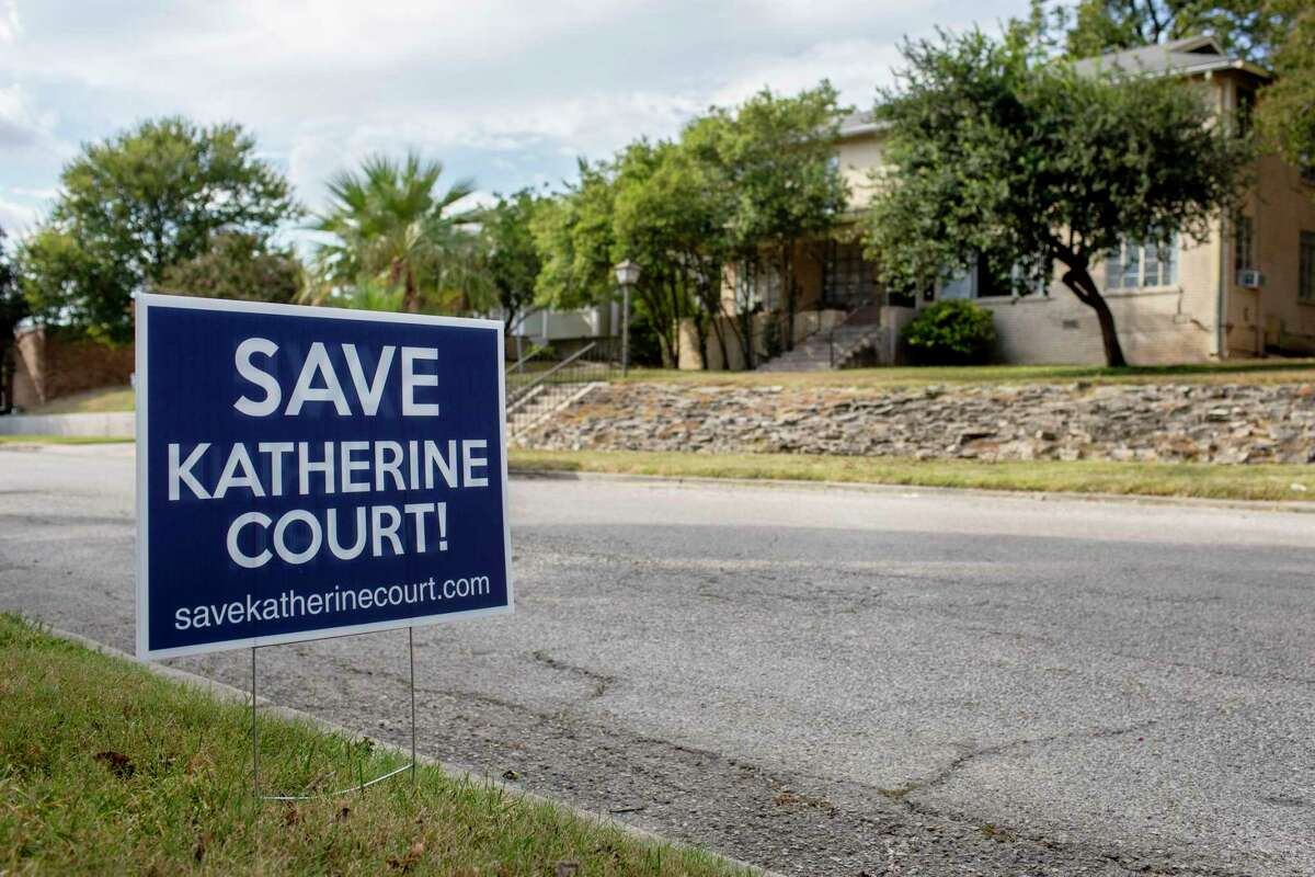 A sign seen Monday opposes the building of an apartment complex on Katherine Court in Alamo Heights.