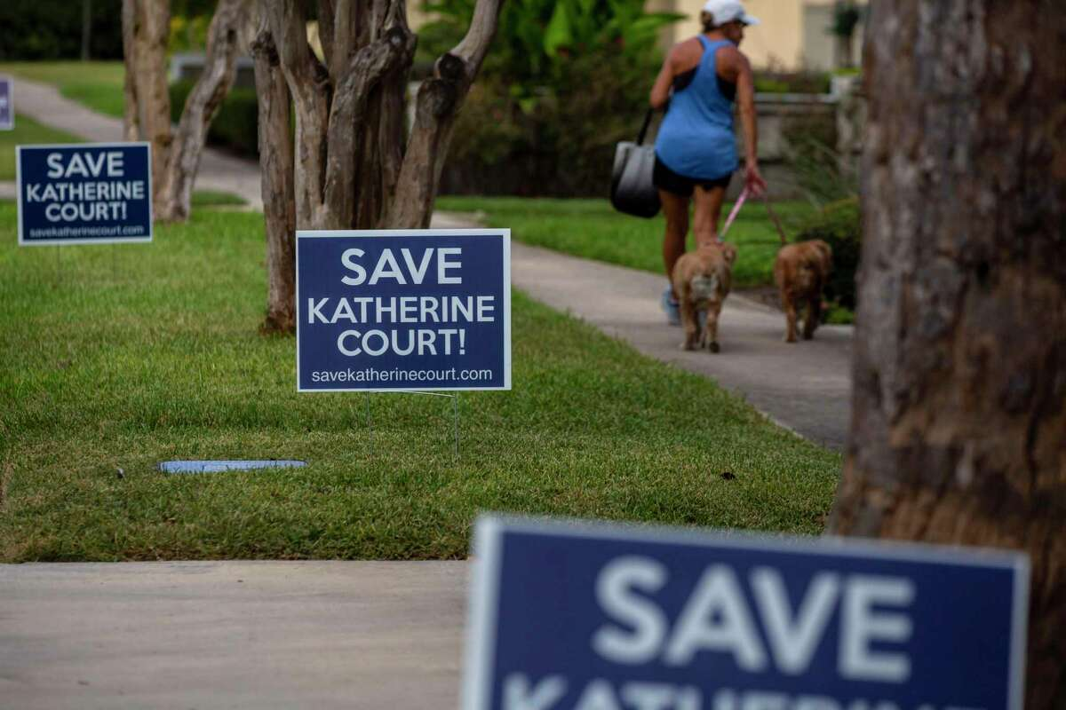 Signs seen Monday opposes the construction of an apartment complex on Katherine Court in Alamo Heights.