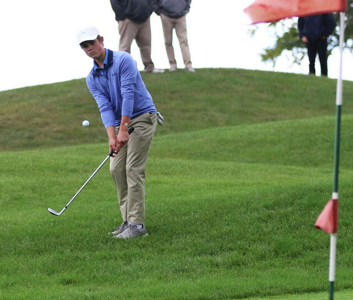 Carlinville's Henry Kufa chips onto a green during last season's SCC Tournament at Indian Springs golf course in Fillmore. the SCC was back at Indian Springs on Monday and Kufa repeated as an All-SCC golfer by placing fourth at 75.