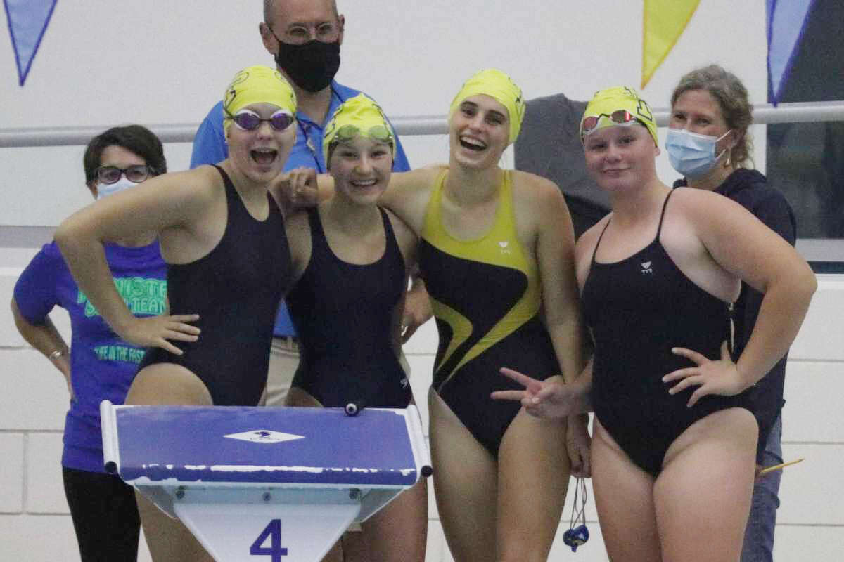 Pictured (left to right) Tatum Jensen, Solana Postma, Laura Eix and Annika Arendt smile for a photo before competing in a relay race during their home swim meet on Sept. 23.