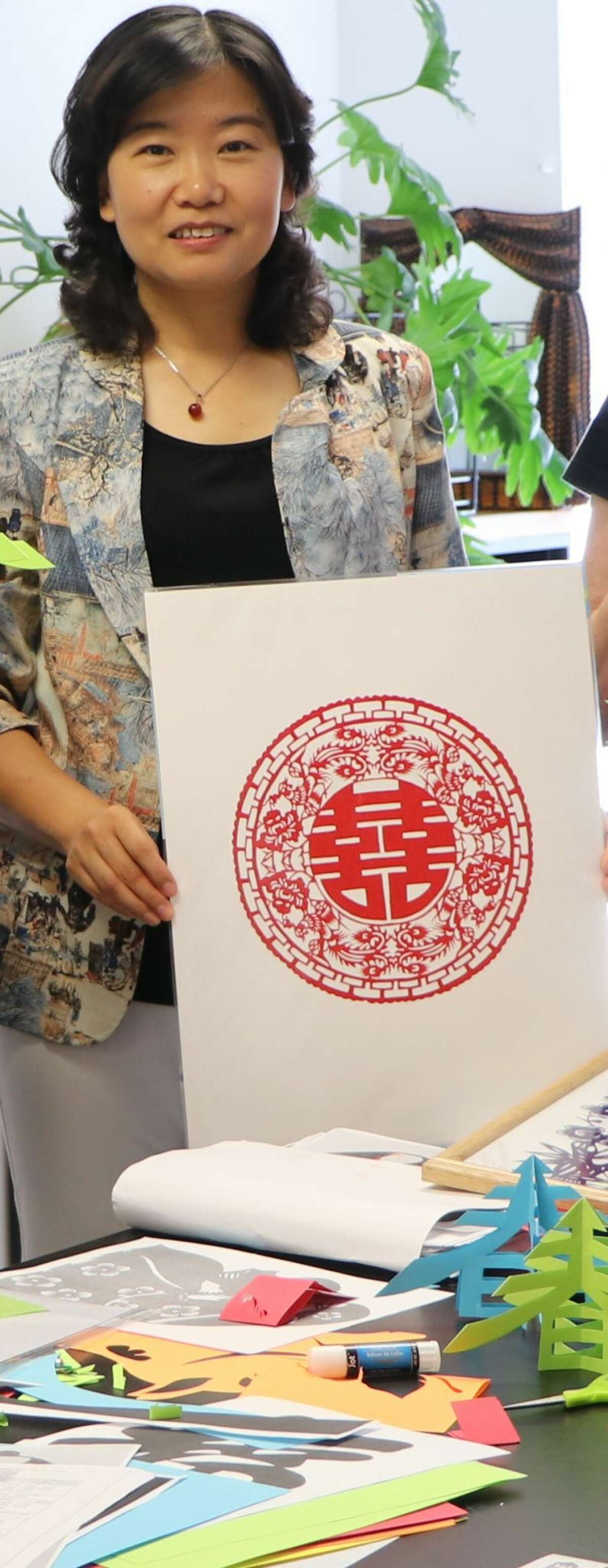 Jianling Yue, who is a master of Chinese papercutting. Yue is a a professor of Chinese language and culture at RPI. (Credits: New York Folklore Society)
