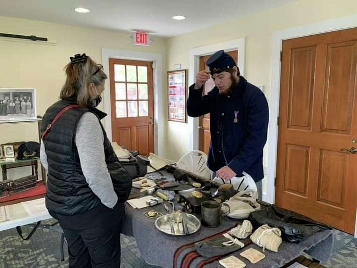 Re-enactor Colon Nash explaining some of the Civil War artifacts on display at the Lake County Historical Museum. (Courtesy photo/LCHS).