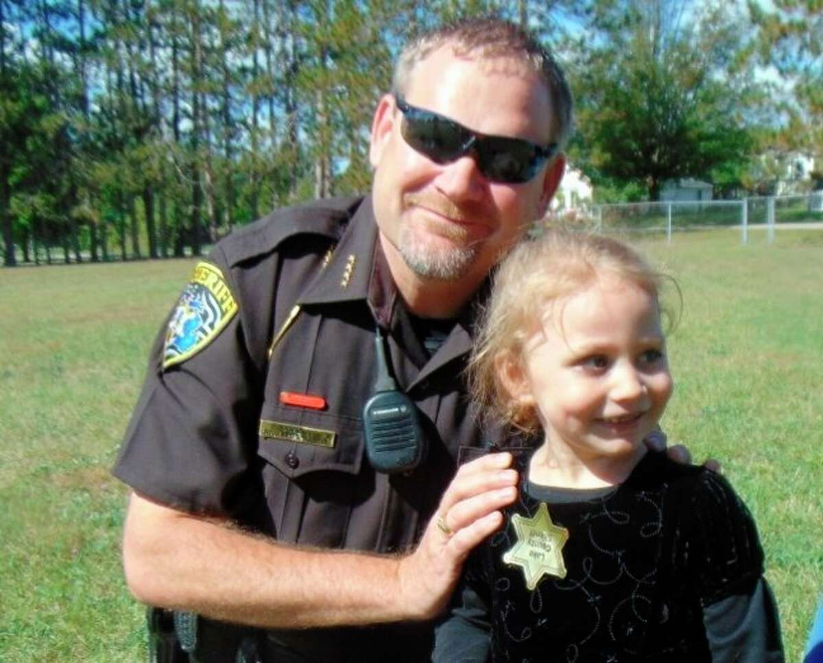 Lake County Sheriff Rich Martin helped crown Abigail Lillian Litwiller Porter as Pickle Princess. (Star photo/Shanna Avery)