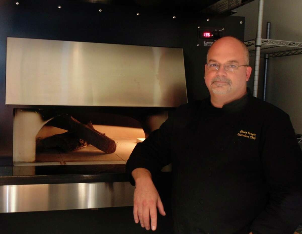 Chef and general manager, Glenn Forgie, fires up the new pizza oven which will be used at the restaurant. (Star photo/Shanna Avery)