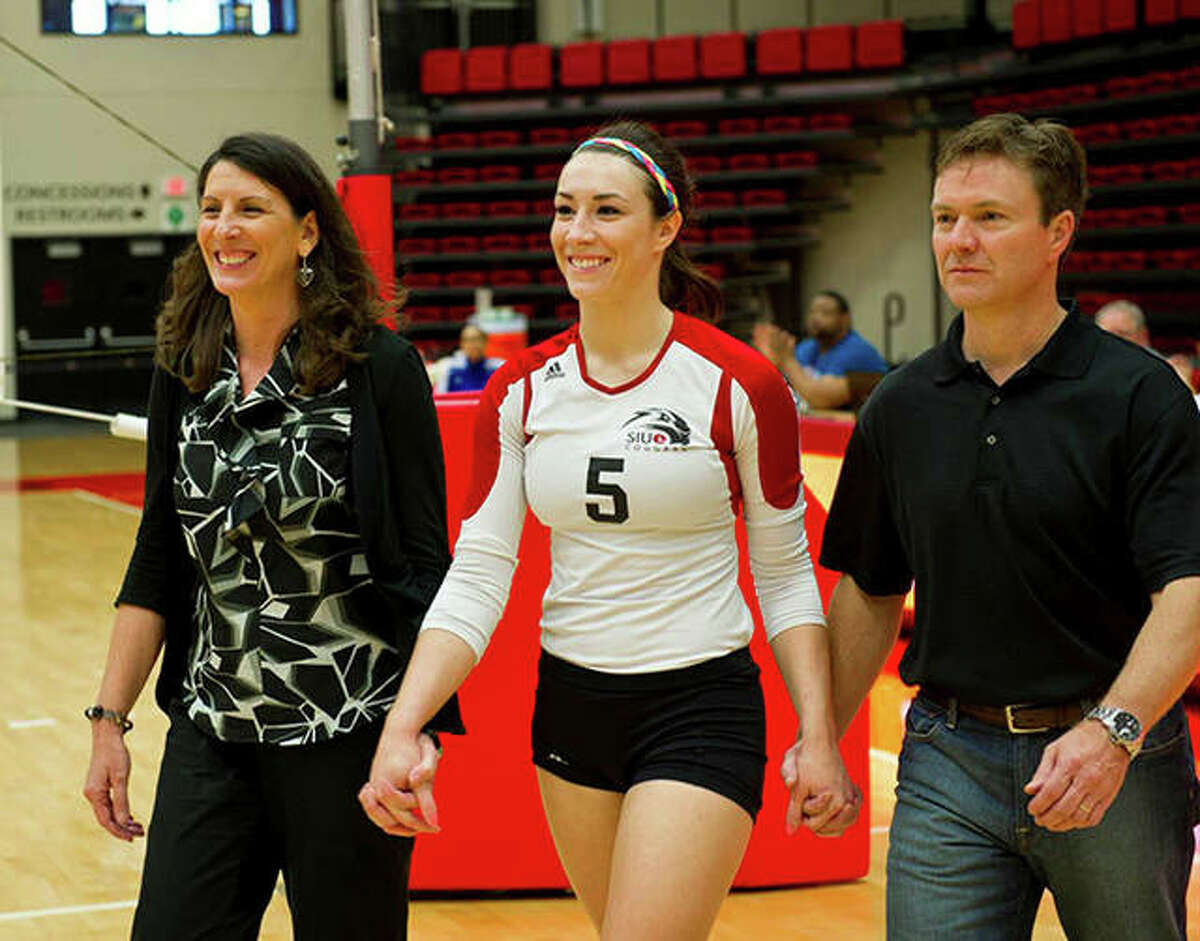 Metro-East Lutheran graduate Brooke Smith, middle, with her parents, Melinda and Vince, during Senior Night with the SIUE volleyball team in 2012.