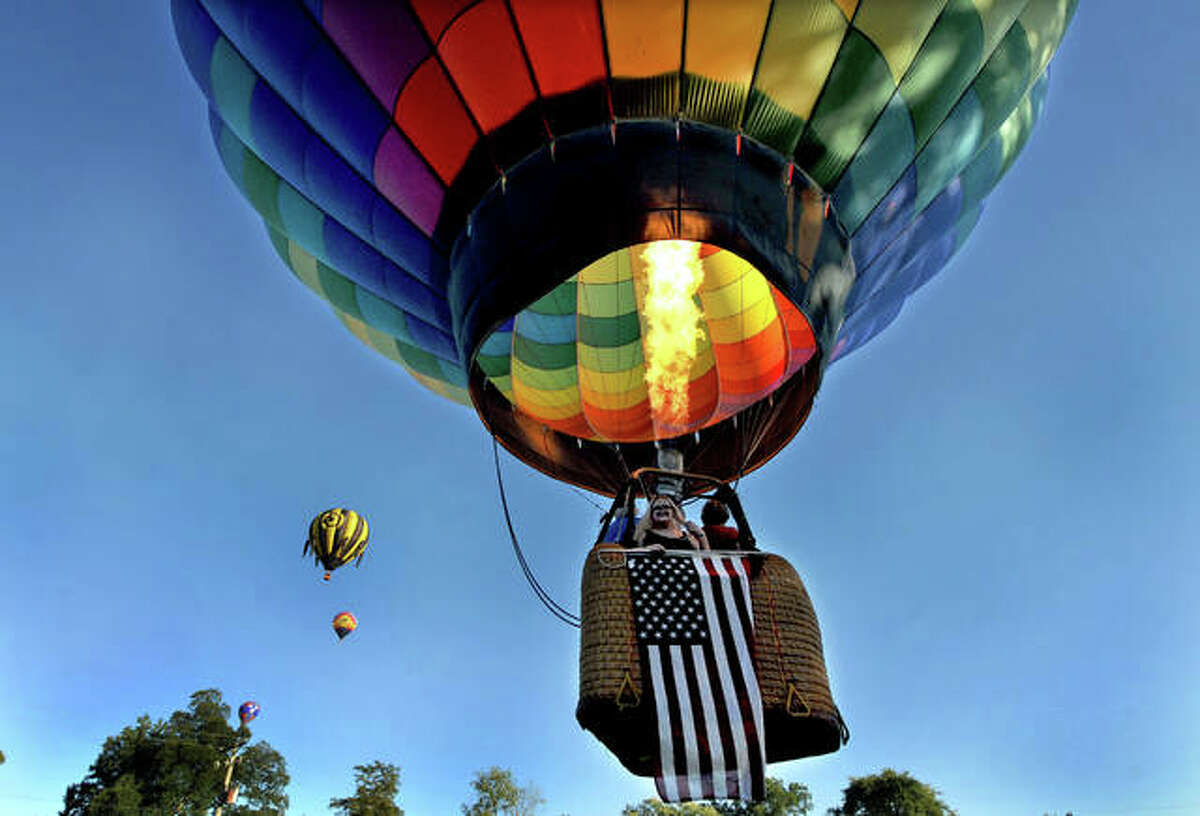 """Balloons over Marine Festival took flight Friday and Saturday over hundreds of people who attended. Themed, """"It's the Great Balloon, Charlie Brown,"""" the festival featured four balloons that launched during the day and """"glowed"""" at night."""