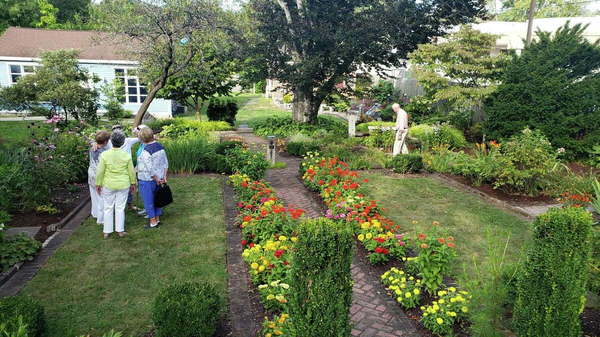 """Danbury Garden Club planted a """"pollinator garden"""" in front of the Rider House at the Danbury Museum. The club is hosting a Harvet Market on Wednesday."""