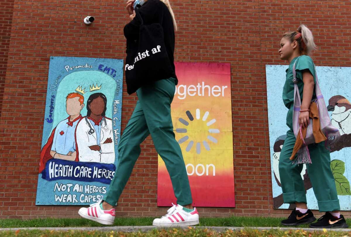 Health care professionals arrive for work at Albany Medical Center on Tuesday, Sept. 28, 2021, on New Scotland Avenue in Albany N.Y.