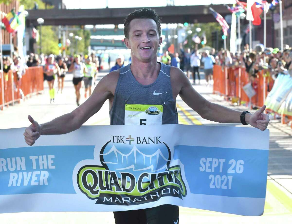 Tyler Pence of Springfield, Ill., finishes first in the TBK Bank Quad Cities Marathon on Sunday, Sept. 26, 2021, in Moline, Ill.