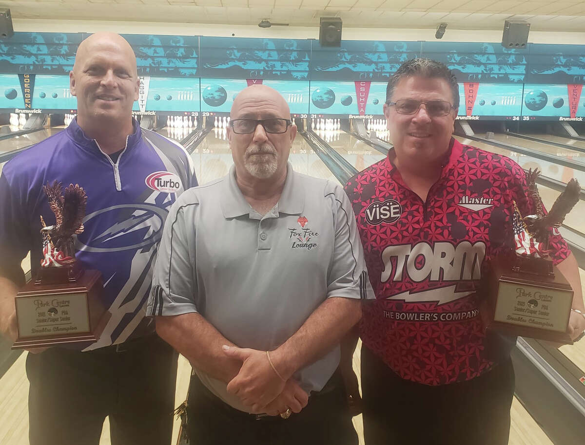 Midland's Bo Goergen (left) and partner Brad Angelo (right) pose with their trophies after winning the PBA50/PBA60 Doubles Central Open at Park Centre Lanes in North Canton, Ohio last Sunday, Sept. 26, 2021.