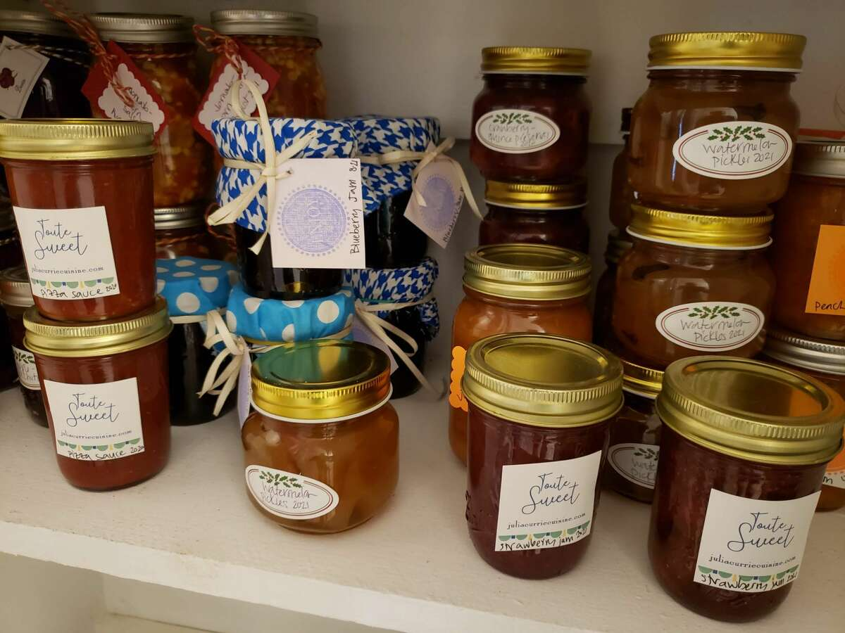 Julia Currie's pantry shelf in Easton is a colorful mix of jars, large and small, labeled or tagged, some dressed for giving with bright cloth caps.