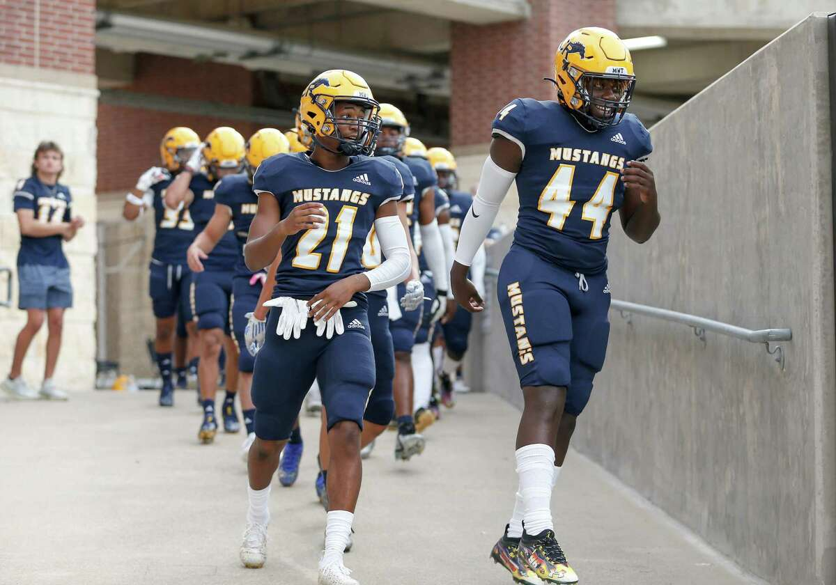 Cypress Ranch Mustangs Jaylon Holland (21) and linebacker Christian Brathwaite (44) take the field to warm up after a weather delay before the high school football game between the Cy-Fair Bobcats and Cypress Ranch Mustangs at Cy-Fair FCU Stadium in Cypress, TX on Thursday, August 26, 2021.