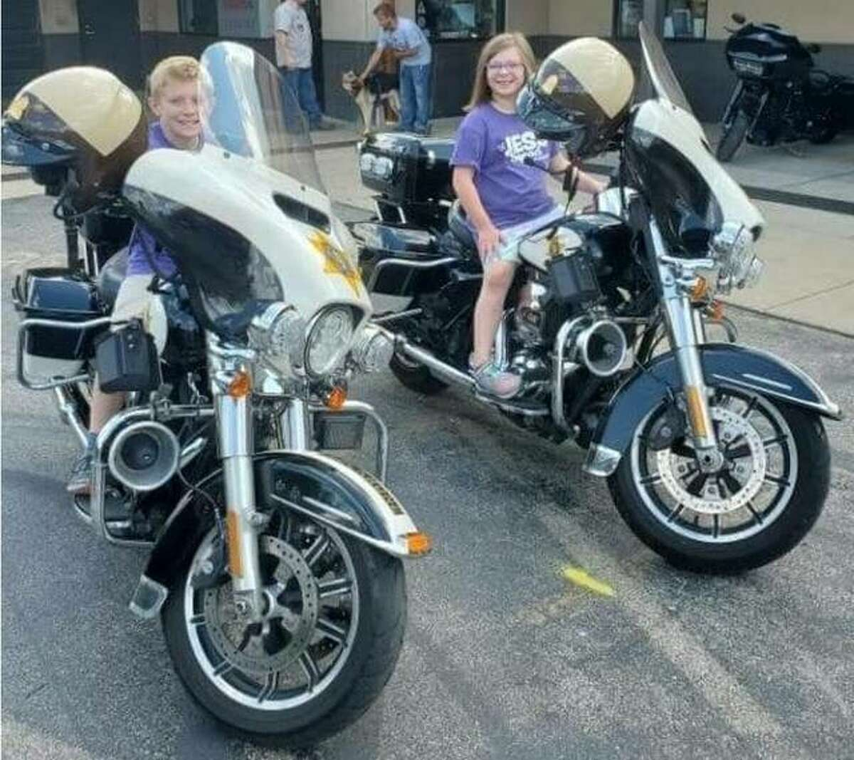 Two Make A Wish children sit on Illinois State Police motorcycles that were used to escort the Ride for Wishes on Sept. 18. This year's event raised more than $11,000.