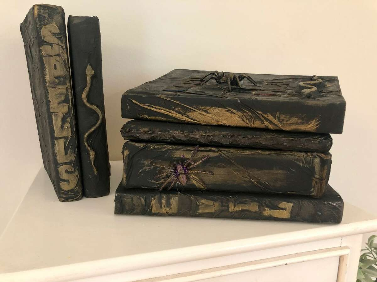Create several spooky books by using old hardcover books, some paper towel, glue and paint.