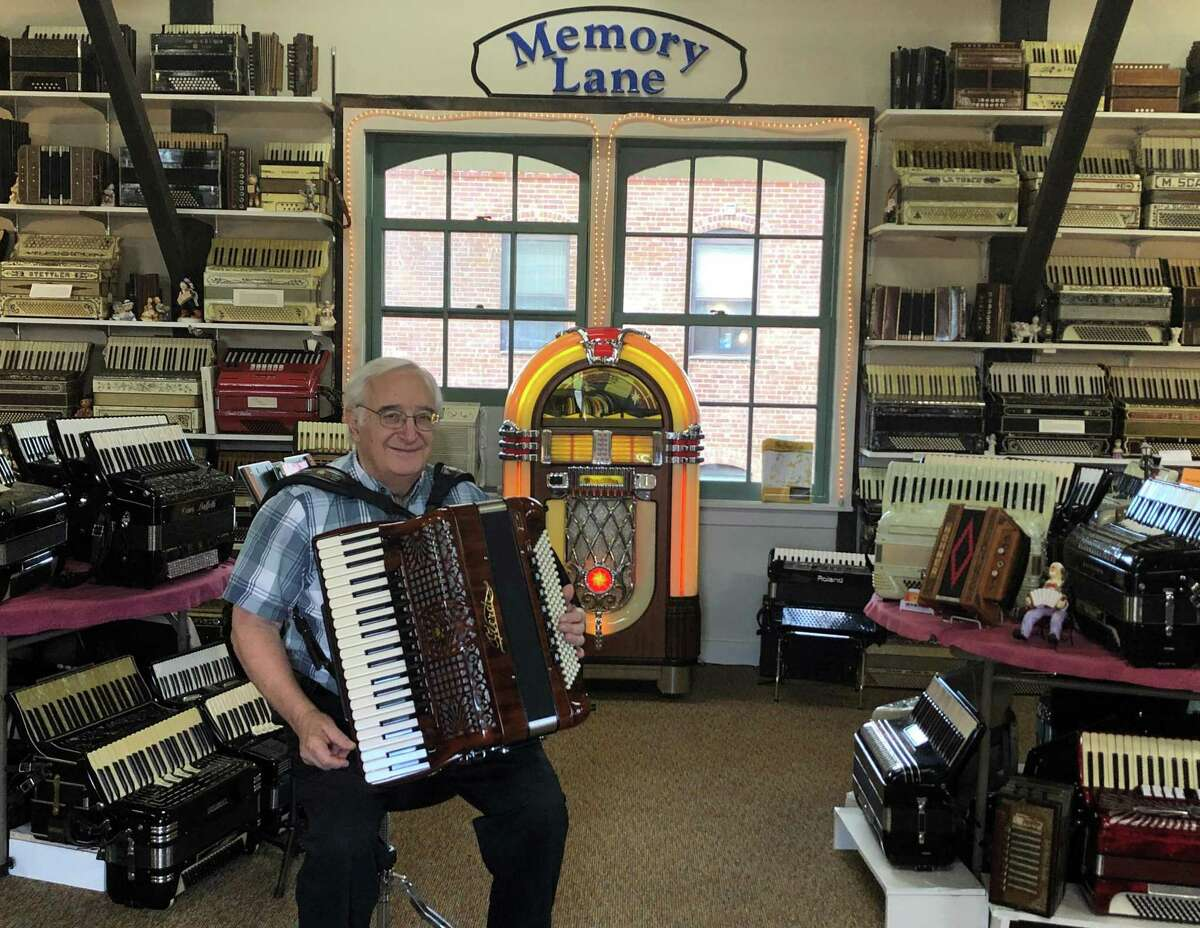 Paul Ramunni, of Salisbury, sits surrounded by accordions inside the new location of the New England Accordion Connection & Museum Company. He recently moved his collection from his home to a new location at the Canaan Union Station.