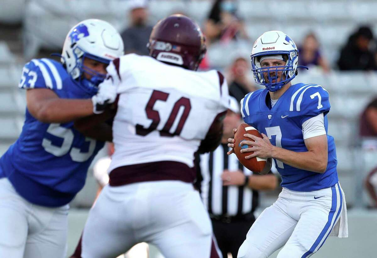 Cypress Creek quarterback Brad Jackson (7) looks to pass during the second quarter of a high school football game, Saturday, Sept. 25, 2021, in Cypress.