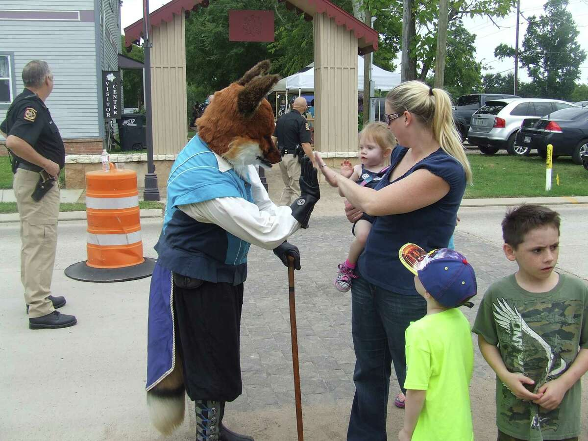 Magnolia residents and visitors enjoy a previous year's Stroll Through the Renaissance in downtown Magnolia. The Texas Renaissance Festival comes to the City of Magnolia for the annual Magnolia Stroll Through the Renaissance on Oct. 2.
