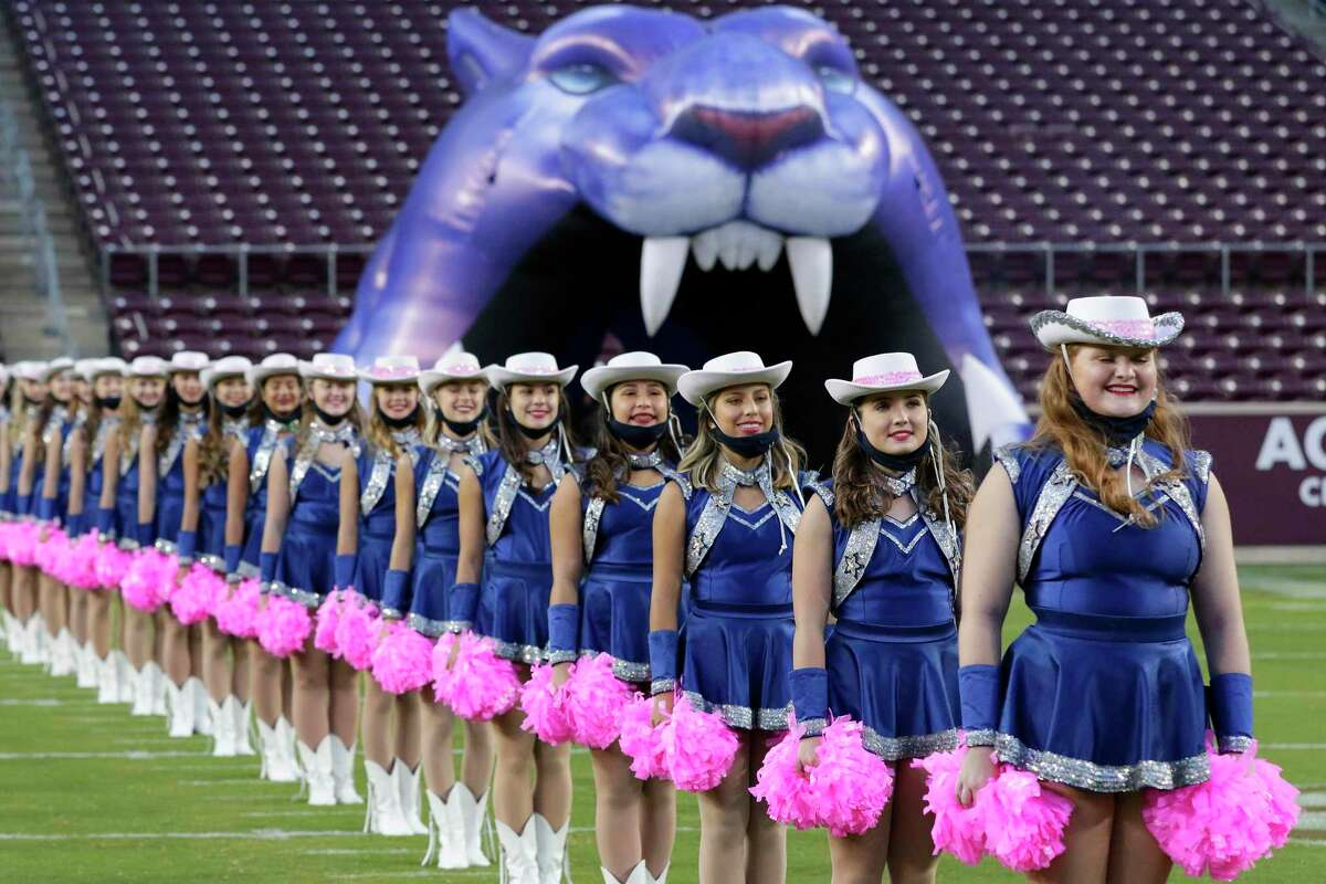 Members of the Tomball Memorial Silver Stars before the first half of a high school football game against Tomball played at Kyle Field Friday, Oct. 16, 2020 in College Station, TX. The Silver Stars Booster Club will present its 2021 Dance Clinic on Oct. 2 at the high school.