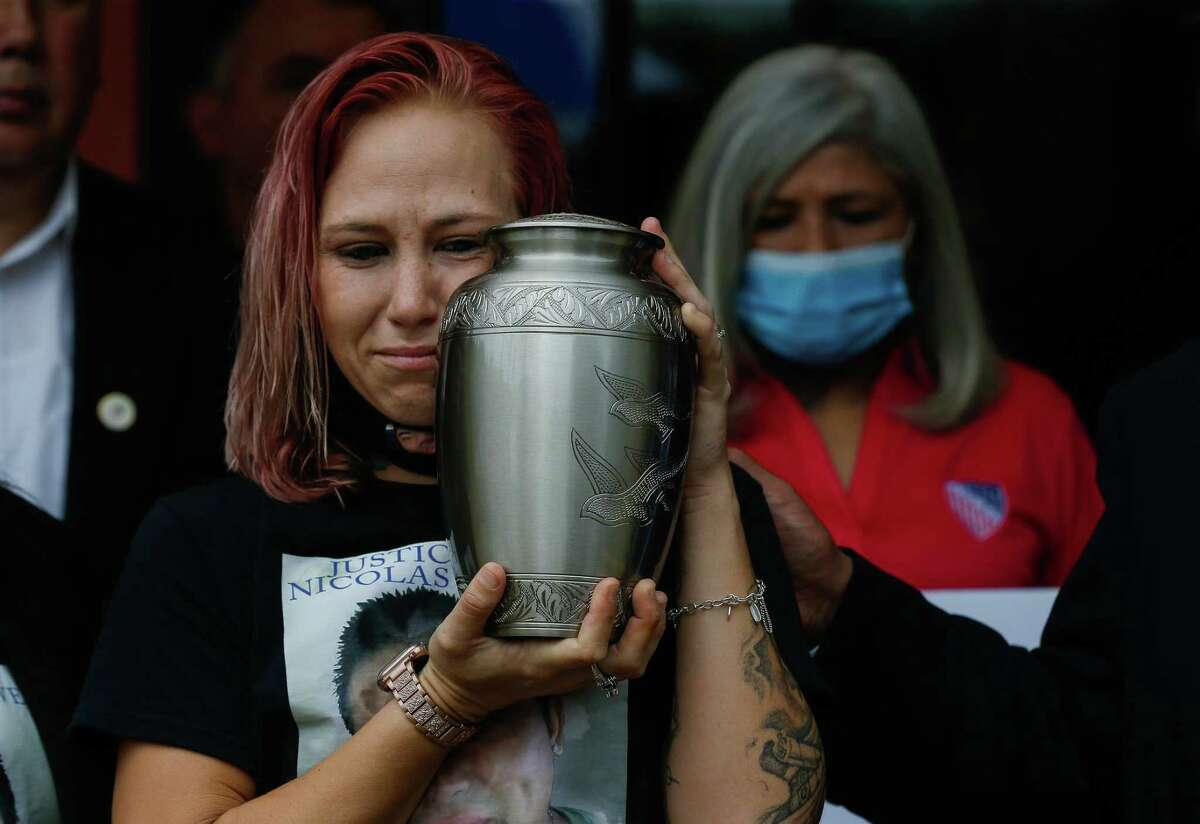 Jessica Chavez holds a urn containing the ashes of Nicolas Chavez, her husband, during a press conference at which family, LULAC members and other community leaders expressed outrage at learning that the Houston Police Department officers fired in Chavez's killing were no-billed by a grand jury, on Tuesday, Sept. 28, 2021, in Houston.