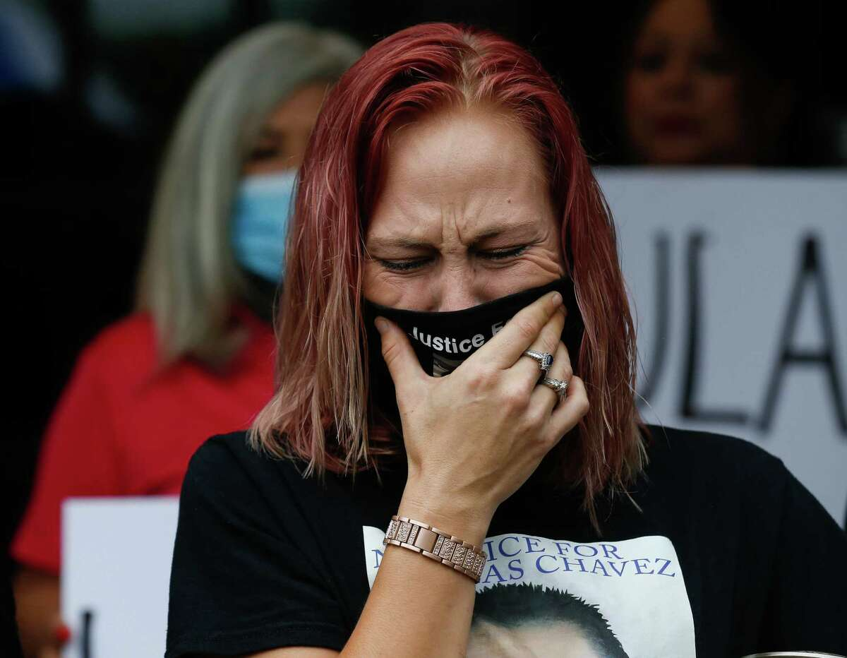 Jessica Chavez cries during a press conference at which family, LULAC members and other community leaders expressed outrage at learning that the Houston Police Department officers fired in the killing of Nicolas Chavez, her husband, were no-billed by a grand jury, on Tuesday, Sept. 28, 2021, in Houston.