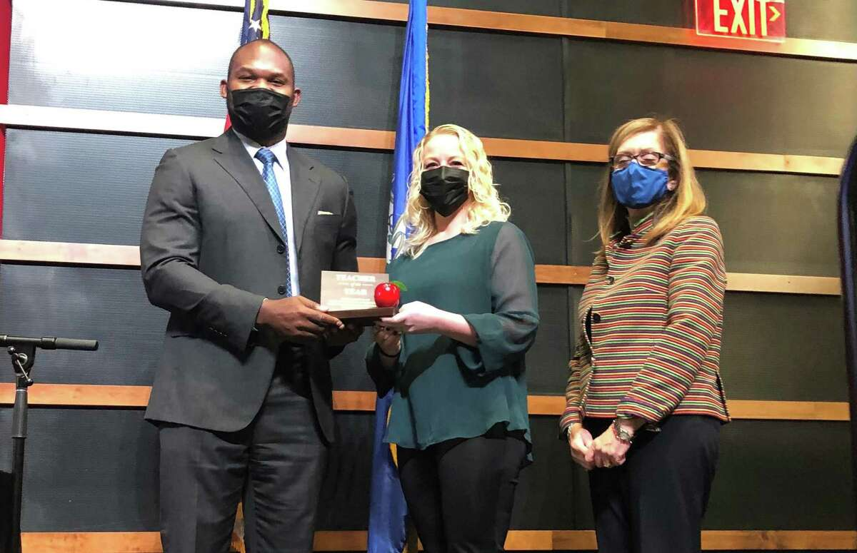 Stratford Schools Superintendent Uyi Osunde, Teacher of the Year Meghan Bova, and Assistant Superintendent Linda Gejda at a Board of Education meeting Sept. 27, 2021.