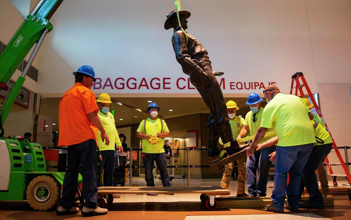 The statue of a Texas Ranger, a fixture at Dallas Love Field airport since 1963, was removed from the airport by a crew from the city of Dallas. (Juan Figueroa/ The Dallas Morning News) The decision was prompted by an excerpt from a book about the law enforcement agency's nearly 200-year history, which includes episodes of police brutality and racism.