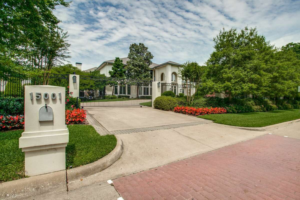 The privately gated home is located at 15001 Winnwood.