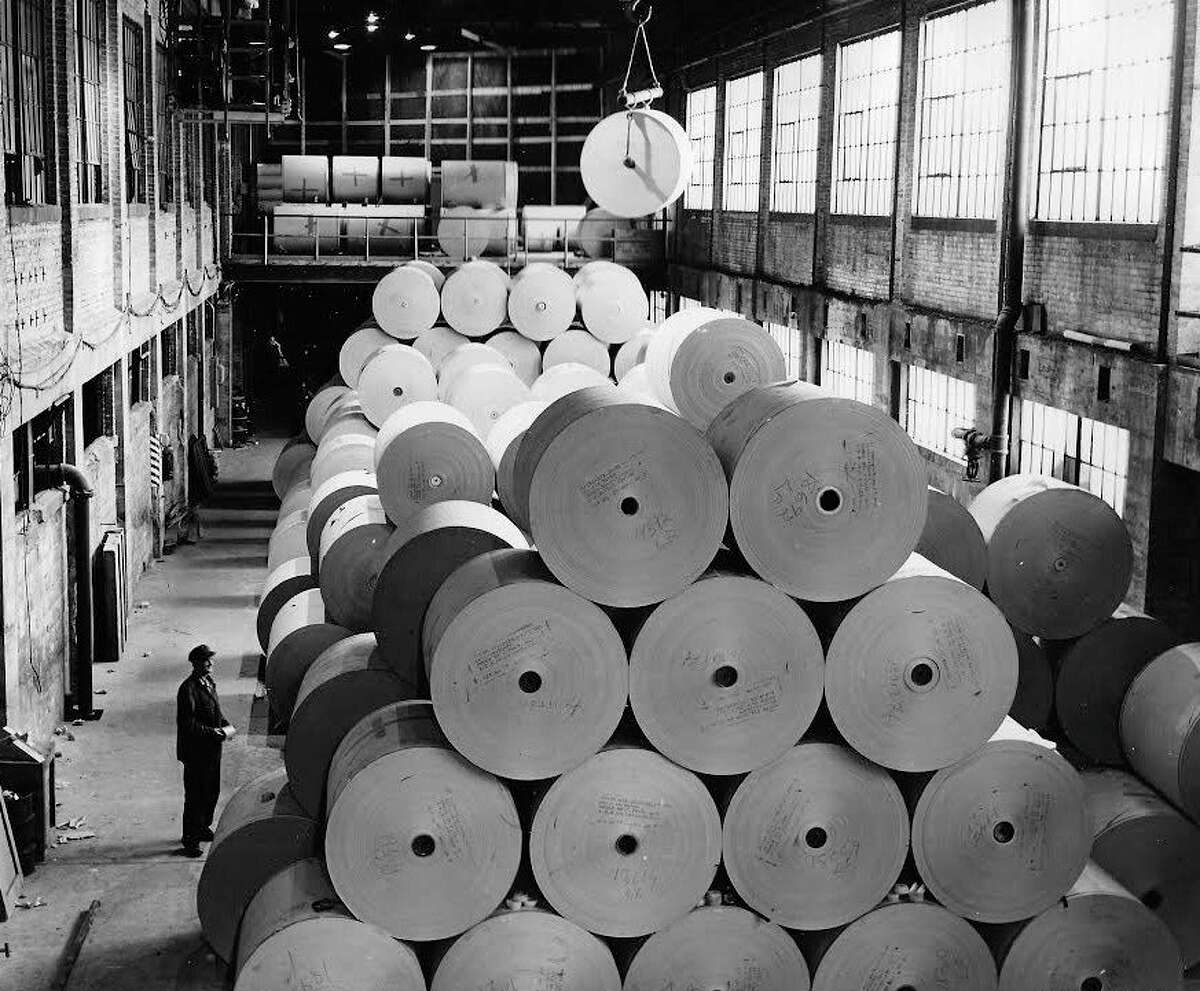 Rolls of paper are readied for shipment by employees of the American Box Board Co. in the early 1950s. The American Box Board Co. merged with several other companies to become known as American Box Board Division of Packaging Corporation of America in 1959. Filer Credit Union startedwithin what was then the American Box Board.(Manistee County Historical Museum photo)
