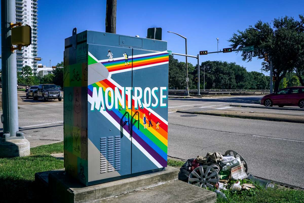 """A mini mural art piece that reads """"Welcome To Montrose"""" painted on an electrical box on the corner of Allen Parkway and Montrose Boulevard."""