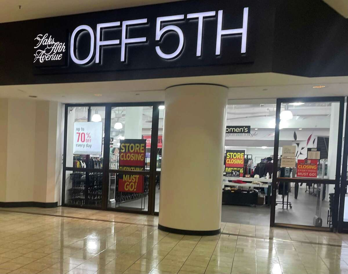 Signs inside the Saks Off 5th department store at Stamford Town Center mall announce the store's upcoming closing.
