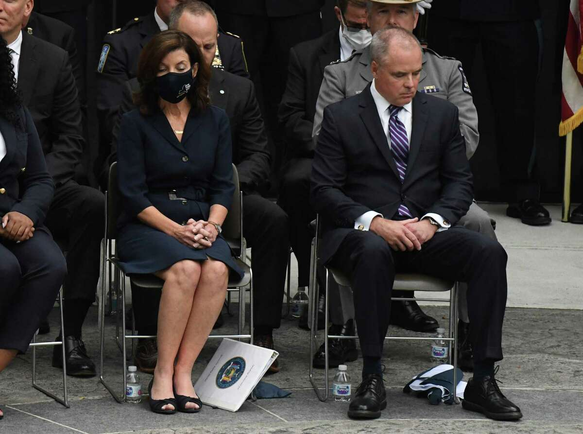 Gov. Kathy Hochul, left, is seated next to New York State Division of Criminal Justice Services Commissioner Mike Green during the New York Police Officers Memorial remembrance ceremony on Tuesday in Albany. Hochul has requested Green's resignation. (Will Waldron / Times Union)