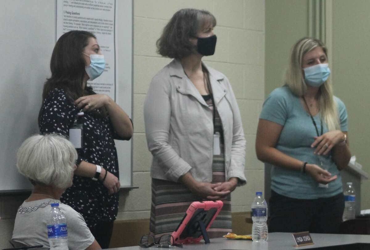 Katie Kinnunen (left), Rowena Perkins and Jenni Buter talk about speech-language pathology during a school board meeting at the Manistee Intermediate School District on Sept. 21.