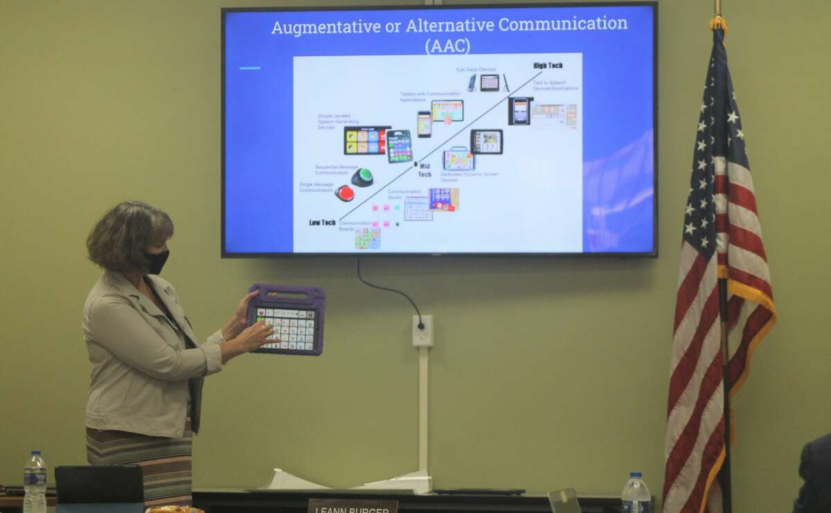 Manistee Intermediate School District speech pathologist Rowena Perkins shows an augmentative and alternative communication device used to help students with communication disorders.